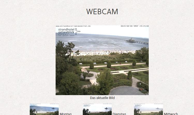 Webcam Heringsdorf blickt über den Strand und die Promenade bis zum Kopf der Seebrücke von Heringsdorf
